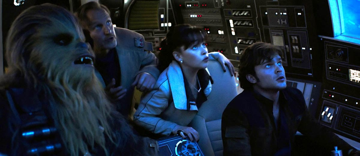 (L to r) Joonas Suotamo as Chewie, Woody Harrelson as Tobias Beckett (Han's mentor), Emilia Clarke as Qi'ra, and Alden Ehrenreich as Han Solo. (Walt Disney Studios)